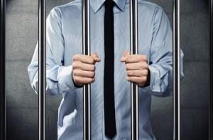 Photo of man behind bars