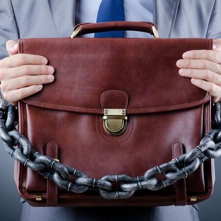 bail bonds represented through briefcase and chain
