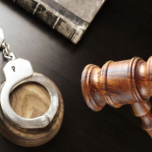 misdemeanor bail represented by handcuffs, gavel, and book