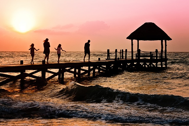 Photo of community, family being together, walking, pier, dock, ocean