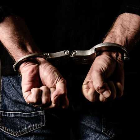 Man in handcuffs who needs bail bond