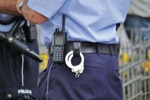 Photo of cop, cuffs, handcuffs, arrest