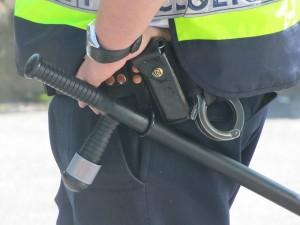 Photo of cop, police, baton, cuffs
