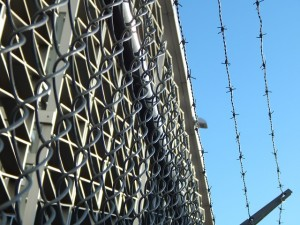 Photo of jail fencing, barbed wire, prison, incarceration